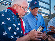 04 JULY 2019  - DES MOINES, IOWA: Former US Vice President JOE BIDEN gets ready to take a selfie with a fan at the Iowa Cubs game. Thirty people became US citizens during a naturalization ceremony at the Iowa Cubs game in Des Moines. The naturalization ceremony is an Iowa Cubs 4th of July tradition. This is the 11th year they've held the ceremony.         PHOTO BY JACK KURTZ