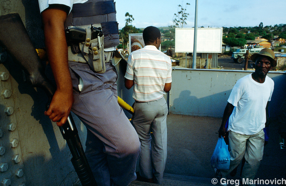 Soweto, Johannesburg. Soweto,  South Africa, A policeman on guard at a train station,  Soweto,  South Africa.