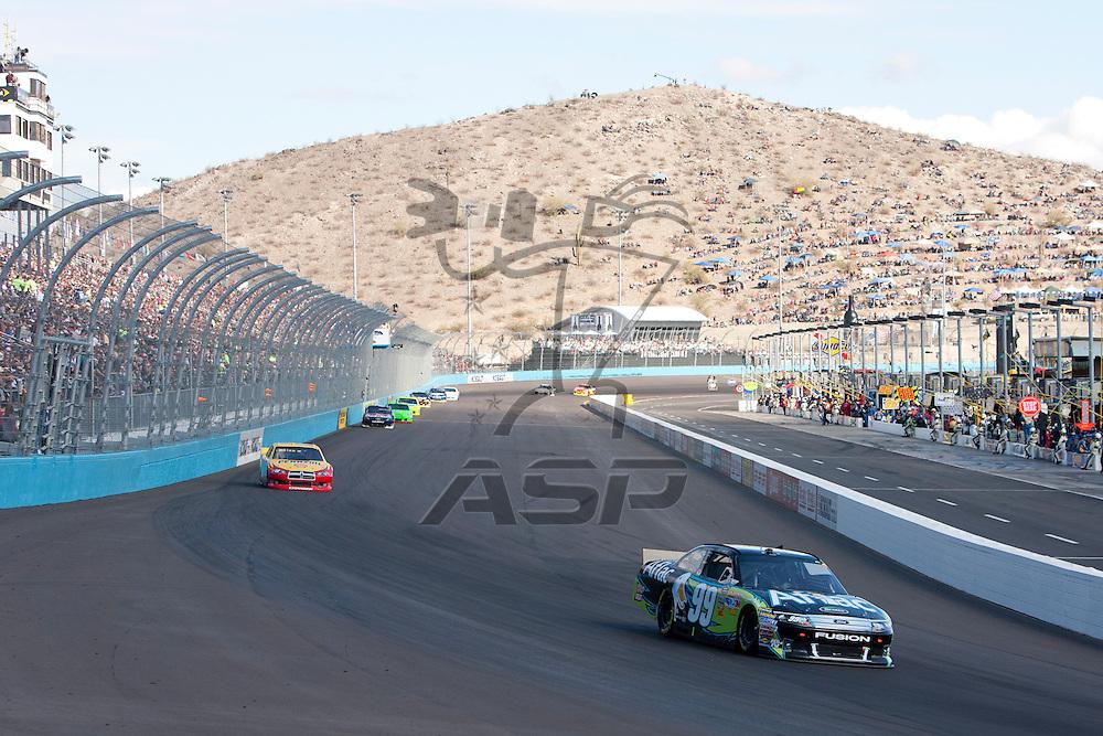 Avondale, AZ - NOV 13, 2011:  Carl Edwards (99) races for the Kobalt Tools 500 race at the Phoenix International Raceway in Avondale, AZ.