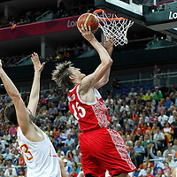 10 August 2012: Russia Andrei Kirilenko goes for the layup past Marc Gasol during 67-59 Team Spain victory over Team Russia, during the men's basketball semi-finals, at the North Greenwich Arena, in London, Great Britain.