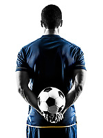 one caucasian soccer player man standing Rear View in silhouette isolated on white background