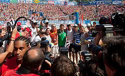 06.08.2011, Klagenfurt, Strandbad, AUT, Beachvolleyball World Tour Grand Slam 2011, im Bild Rainhard Fendrich und Hannes Jagerhofer mit den österreichischen Beachvolleyball Stars, EXPA Pictures © 2011, PhotoCredit EXPA Erwin Scheriau