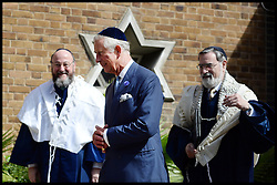 Prince Charles talks to the New Chief UK Rabbi Ephraim Mirvis (left) at his Installation at St John's Wood Synagogue, and the Out going Chief Rabbi Lord Jonathan Sacks (middle), who has held the post since 1991, London, United Kingdom. Sunday, 1st September 2013. Picture by Andrew Parsons / i-Images