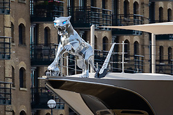 © Licensed to London News Pictures. 30/10/2019. London, UK.  A silver Jaguar, which has one of its paws resting on a silver American football helmet at the front of 308 feet long luxury superyacht, Kismet owned by Pakistani American billionaire businessman, Shahid Khan is seen moored at Butlers Wharf near Tower Bridge on the River Thames. Shahid Khan owns the National Football League (NFL) team, the Jacksonville Jaguars, who are due to play the Houston Texans in an International Series game at Wembley this Sunday. Kismet has 6 staterooms, with the master bedroom having its own private deck with jacuzzi and helipad and can be chartered for an estimated £1m per week.Photo credit: Vickie Flores/LNP
