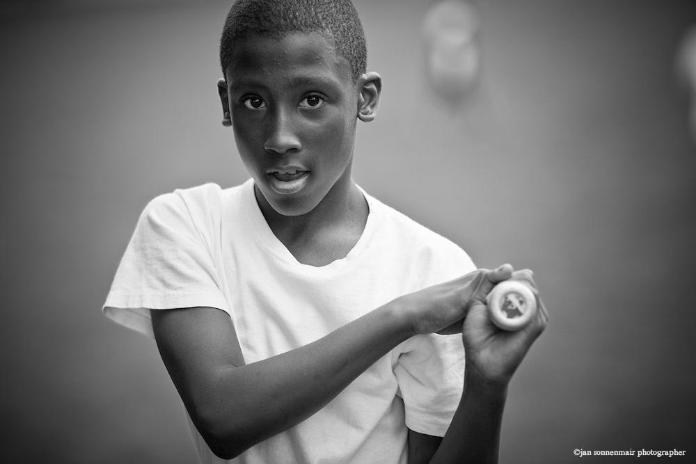 An african American boy playing baseball