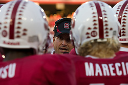September 26, 2009; Stanford, CA, USA; Stanford Cardinal head coach Jim Harbaugh talks to his team during a timeout in the first quarter against the Washington Huskies at Stanford Stadium.
