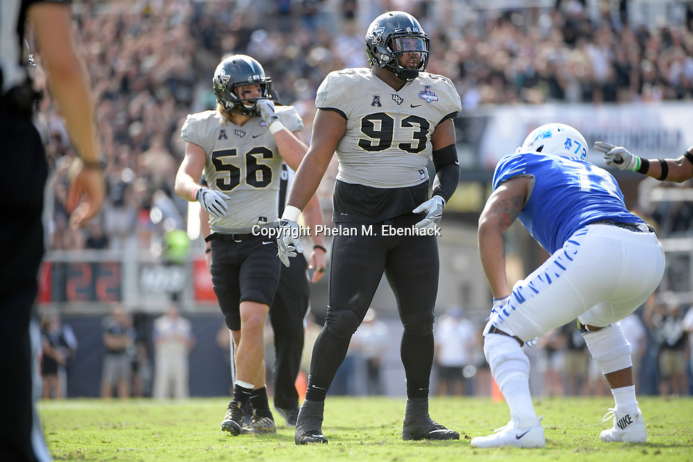 Central Florida defensive lineman Tony Guerad (93) sets up for a play in front of Memphis offensive lineman Trevon Tate (72) during the first half of the American Athletic Conference championship NCAA college football game Saturday, Dec. 2, 2017, in Orlando, Fla. (Photo by Phelan M. Ebenhack)