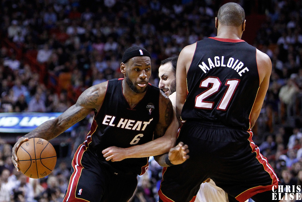 14 March 2011: Miami Heat small forward LeBron James (6) drives past San Antonio Spurs shooting guard Manu Ginobili (20) on a screen set by Miami Heat center Jamaal Magloire (21) during the Miami Heat 110-80 victory over the San Antonio Spurs at the AmericanAirlines Arena, Miami, Florida, USA.