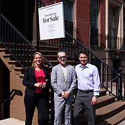 June 1, 2016 - New York, NY : The Missionary Sisters of the Immaculate Heart of Mary (I.C.M.)  are selling their 25-bedroom, two-story, combined two-townhome property located at 236 East 15th Street. Here, from left, Compass Licensed Real Estate Salesperson Lisa Kobiolke, Compass President Leonard Steinberg, and Compass Licensed Associate Real Estate Broker Dylan Hoffman posed for a portrait outside the home on Wednesday morning. The trio are handling the sale of the property. CREDIT: Karsten Moran for The New York Times