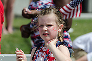 BAR HARBOR, MAINE, July 4, 2014. A young marcher in the Independence Day Parade throws candy to the crowd.