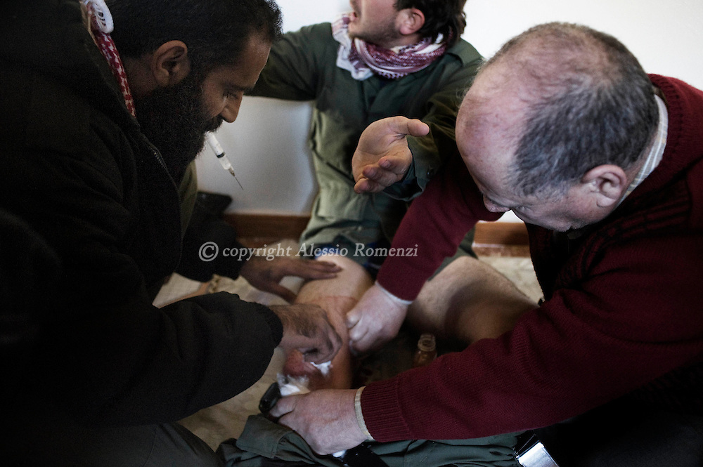 SYRIA - Al Qsair. An injured member of Free Syrian Army receive first aid in an house in Al Qsair, on January 28, 2012. Al Qsair is a small town of 40000 inhabitants, located 25Km south-west of Homs. The town is besieged since the beginning of November and so far it counts 65 dead. ALESSIO ROMENZI