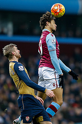 Rudy Gestede of Aston Villa and Per Mertesacker of Arsenal compete in the air - Mandatory byline: Rogan Thomson/JMP - 13/12/2015 - FOOTBALL - Villa Park Stadium - Birmingham, England - Aston Villa v Arsenal - Barclays Premier League.