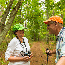 A man and woman birdwaching in Ipswich, Massachusets.