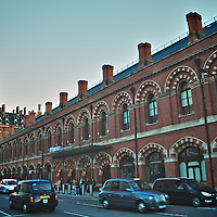 London St Pancras Station exterior view with London taxis and traffic