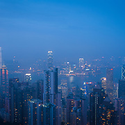 View of Hong Kong Island and Kowloon from the Peak on a foggy evening.