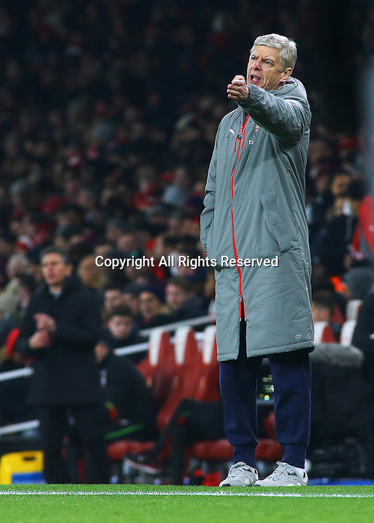 30.11.2016. Emirates Stadium, London, England. EFL Cup Football, Quarter Final. Arsenal versus Southampton. Arsenal Manager Arsène Wenger reacts during a Southampton injury, and appeals to Referee Kevin Friend about time wasting.