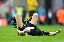 LONDON, ENGLAND - Saturday, May 17, 2008: Cardiff City's Glenn Loovens lies dejected on the pitch after losing 1-0 to Portsmouth during the FA Cup Final at Wembley Stadium. (Photo by David Rawcliffe/Propaganda)