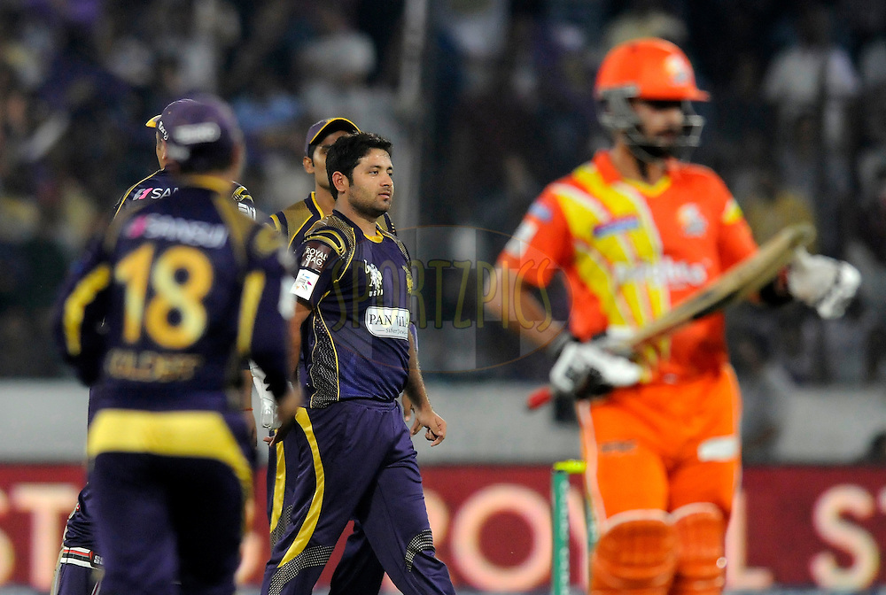 Piyush Chawla of Kolkata Knight Riders celebrates the wicket of Ahmed Shehzad of Lahore Lions during match 7 of the Oppo Champions League Twenty20 between the Kolkata Knight Riders and the Lahore Lions held at the Rajiv Gandhi Cricket Stadium, Hyderabad, India on the 21st September 2014<br /> <br /> Photo by:  Pal Pillai / Sportzpics/ CLT20<br /> <br /> <br /> Image use is subject to the terms and conditions as laid out by the BCCI/ CLT20.  The terms and conditions can be downloaded here:<br /> <br /> http://sportzpics.photoshelter.com/gallery/CLT20-Image-Terms-and-Conditions-2014/G0000IfNJn535VPU/C0000QhhKadWcjYs