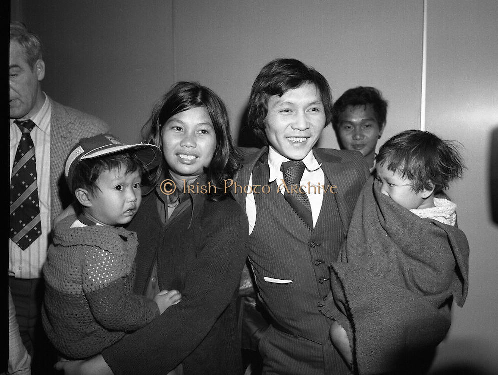 Vietnamese Refugees Arrive In Dublin  (N66)..1981..18.03.1981..03.18.1981..18th March 1981..As part of a resettlement plan initiated by the United nations, Ireland agreed to accept into the country a number of Vietnamese families displaced by the Vietnam war...Image shows Mr Nga Van Thai, his wife and two children on their arrival at Dublin Airport, they were part of a group of 17 who hoped to settle here.