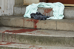 © Licensed to London News Pictures.  15/02/2012. LUTON, UK. Steps near a row of clubs in Luton, are covered in blood after a fight broke out early this morning (Wed) after a Valentine's Day event. Over 100 people are thought to have been involved. Two people were stabbed and three police officers injured. Photo credit :  Cliff Hide/LNP