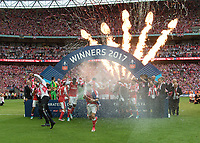 Football - 2017 FA Cup Final - Arsenal vs. Chelsea<br /> <br /> Arsenal celebrate winning the FA Cup as Alexi Sanchez rushes towards the photographers at Wembley.<br /> <br /> COLORSPORT/DANIEL BEARHAM