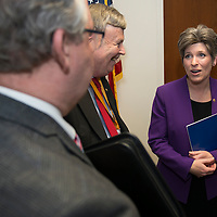 U.S. Sneator Jodi Ernst (R-IA) speaks with members of the Iowa Bar Association on April 15, 2015 out side her Washington, DC office.