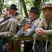 Confederate reenactors listen to a music played by the drum and fife corps prior to taking part in a reenactment of Pickett's Charge, during the Sesquicentennial Anniversary of the Battle of Gettysburg, Pennsylvania on Sunday, June 30, 2013.  A pivotal moment in the Civil War, over 50,000 soldiers were killed, wounded or missing after 3 days of battle from July 1-3, 1863.  Later that year, President Abraham Lincoln returned to Gettysburg to deliver his now famous Gettysburg Address to dedicate the cemetery there for the Union soldiers who died in battle.  John Boal photography