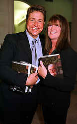 Singer MICHAEL BALL and MISS CATHY McGOWAN, at a party in London on 11th October 1999.MXK 53