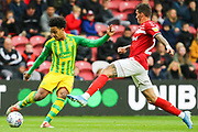 West Bromwich Albion midfielder Matheus Pereira (12) looks to cross the ball as Middlesbrough midfielder Marvin Johnson (21) tries to block it during the EFL Sky Bet Championship match between Middlesbrough and West Bromwich Albion at the Riverside Stadium, Middlesbrough, England on 19 October 2019.