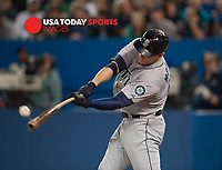 Sep 24, 2014; Toronto, Ontario, CAN; Seattle Mariners Logan Morrison (20) batting against Toronto Blue Jays at Rogers Centre. Mandatory Credit: Peter Llewellyn-USA TODAY Sports