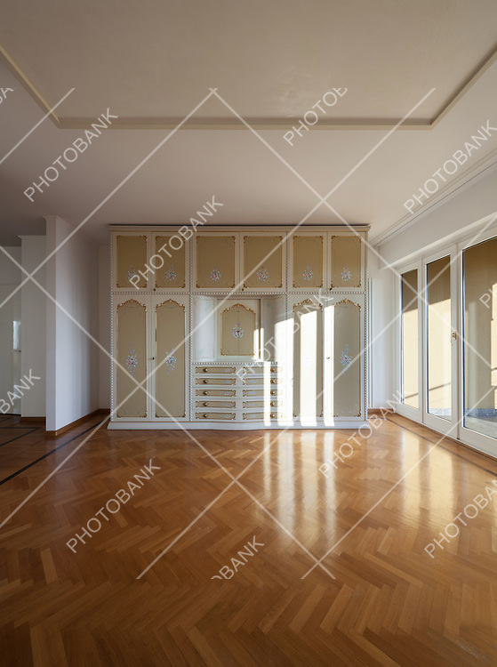 interior of an house, empty room with a period closet, parquet floor