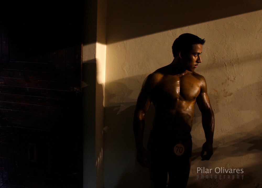A competitor waits for his turn during a bodybuilding competition in Lima January 30, 2010.