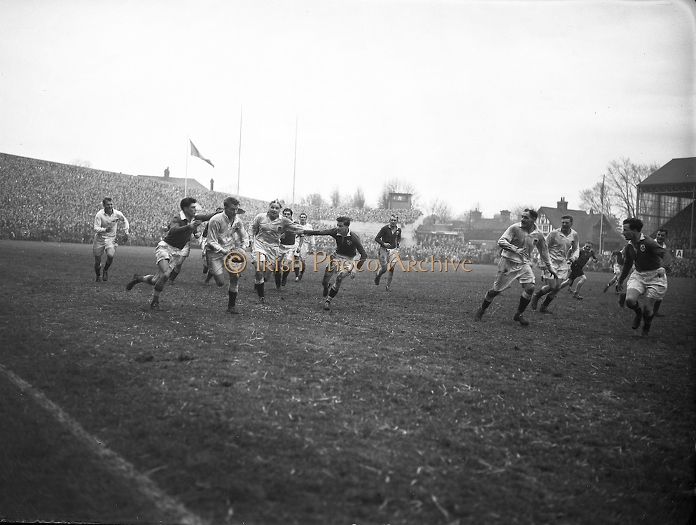 Irish Rugby Football Union, Ireland v England, Five Nations, Landsdowne Road, Dublin, Ireland, Saturday 14th February, 1953,.14.2.1953, 2.14.1953,..Referee- MR A W C Austin, Scottish Rugby Union, ..Score- Ireland 9 - 9 England, ..Irish Team,..R J Gregg, Wearing number 15 Irish jersey, Full Back, Queens University Rugby Football Club, Belfast, Northern Ireland,..M F Lane,  Wearing number 14 Irish jersey, Right wing, University college Cork Football Club, Cork, Ireland,  ..N J Henderson, Wearing number 13 Irish jersey, Right centre, N.I.F.C, Rugby Football Club, Belfast, Northern Ireland,..K Quinn, Wearing number 12 Irish jersey, Left Centre, Old Belvedere Rugby Football Club, Dublin, Ireland,  ..M Mortell, Wearing number 11 Irish jersey, Left wing, Bective Rangers Rugby Football Club, Dublin, Ireland,.  .J W Kyle, Wearing number 10 Irish jersey, Stand Off, Captain of the Irish team, N.I.F.C, Rugby Football Club, Belfast, Northern Ireland,..J A O'Meara, Wearing number 9 Irish jersey, Scrum, University college Cork Football Club, Cork, Ireland,  ..W A O'Neill, Wearing number 1 Irish jersey, Forward, University College Dublin Rugby Football Club, Dublin, Ireland, ..R Roe, Wearing number 2 Irish jersey, Forward, Dublin University Rugby Football Club, Dublin, Ireland,..F E Anderson, Wearing number 3 Irish jersey, Forward, Queens University Rugby Football Club, Belfast, Northern Ireland,..T E Reid, Wearing number 4 Irish jersey, Forward, Garryowen Rugby Football Club, Limerick, Ireland, ..J R Brady, Wearing number 5 Irish jersey, Forward, C I Y M S Rugby Football Club, Belfast, Northern Ireland, . .J S McCarthy, Wearing number 6 Irish jersey, Forward, Dolphin Rugby Football Club, Cork, Ireland, ..R Kavanagh, Wearing number 7 Irish jersey, Forward, University College Dublin Rugby Football Club, Dublin, Ireland,..W E Bell, Wearing number 8 Irish jersey, Forward, Collegians Rugby Football Club, Belfast, Northern Ireland,.  .Engish Team,..N M Hall, Wearing number 1 Engish jers