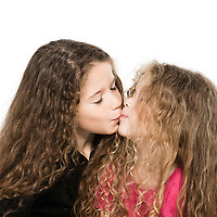 two caucasian little girls portrait kissing isolated studio on white background