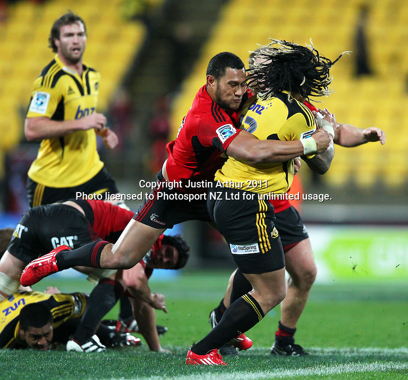 Crusaders Robbie Fruean wraps up  Ma'a Nonu  .Super15 rugby union match - Crusaders v Hurricanes at Westpac Stadium, Wellington, New Zealand on Saturday, 18 June 2011. Photo: Justin Arthur / photosport.co.nz