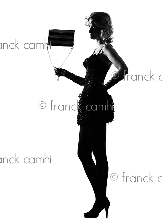 stylish silhouette caucasian beautiful with purse woman sexy  attitude behavior clothes full length on studio isolated white background