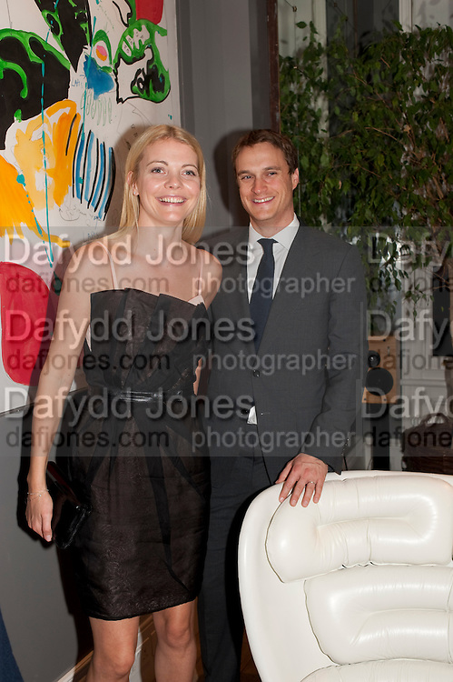 JEMMA KIDD; EARL OF MORNINGTON, Party hosted for Jason Wu by Plum Sykes and Christine Al-Bader. Ladbroke Grove. London. 22 March 2011. -DO NOT ARCHIVE-© Copyright Photograph by Dafydd Jones. 248 Clapham Rd. London SW9 0PZ. Tel 0207 820 0771. www.dafjones.com.
