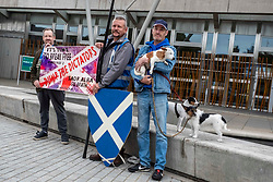 Pictured: Shaun Jones, Cliffe Serbie, Dean Halliday (Scottish) and his three dogs Fern, Saorsa and Indy<br />