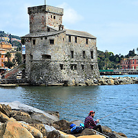 Fisherman Along Harbor in Rapallo, Italy <br />