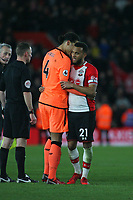 Football - 2017 / 2018 Premier League - Southampton vs. Liverpool<br /> <br /> Virgil van Dijk of Liverpool embraces and chats to Southampton's Ryan Bertrand after the final whistle at St Mary's Stadium Southampton<br /> <br /> COLORSPORT/SHAUN BOGGUST