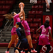 10 February 2018: The San Diego State Aztecs women's basketball team hosts Nevada on Play4Kay day at Viejas Arena. San Diego State Aztecs forward Baylee Vanderdoes (34) and guard Naje Murray (10) bring down a defensive rebound in the fist half. <br /> More game action at www.sdsuaztecphotos.com