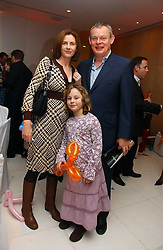 Actor MARTIN CLUNES, his wife PHILIPPA BRAITHWAITE and their daughter EMILY  at the English National Ballet's Mad Hatters Tea Party at St.Martins Lane Hotel, St Martins Lane, London on 12th December 2006.<br />