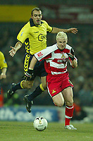 Photo: Aidan Ellis.<br /> Doncaster Rovers v Aston Villa. Carling Cup. 29/11/2005.<br /> Doncaster's Sean Thornton skips away from Villa's Gavin McCann