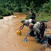 The Gurage landscape ranges from jungles to fast-flowing rivers. It has been raining in Gurage with an unusual strength in recent times, possibly due to the climate change. Here, the problem with searching for water lies in the sudden rises in the river level. Several residents of the small village of Chaha have died as they were swept away by the current. Gurage, Ethiopia.