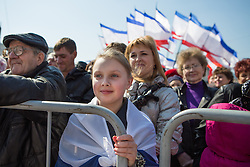 Crimea one day before the referendum. A young girls enjoys the music and performances in a Pro Russian rally  at Simferopol's Lenin Square. Simferopol, . Saturday, 15th March 2014. Picture by Daniel Leal-Olivas / i-Images