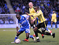 Photo: Tony Oudot/Richard Lane Photography. Gillingham v Burton Albion. FA Cup 2nd Round. 28/11/2009. <br /> Febian Brandy of Gillingham moves away from Keiron Cadogan and John McGrath of Burton Albion