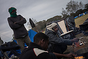 Sudaneese migrants cooking at the jungle Camp