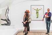 Divine Proportion 1967 by Equipo Realidad - The EY Exhibition: The World Goes Pop, opens at the Tate Modern. The exhibition covers the full breadth of international Pop Art from the 1960s and 70s, 'exploding' the traditional story of Pop. The show features 'colourful and exciting' works from Latin America, Asia, Europe and the Middle East – the majority of which have never before been shown in the UK. Highlights include: Japanese pop artist Tajiri's striking large scale sculpture Machine No.7, surrounded by works by artists Ushio Shinohara, Erro, Equipo Cronica and Evelyne Axel; a mirrored full room installation specially recreated for this exhibition by Polish pop artist Jana Zelibska; and Henri Cueco's multi-layered sculptural work Large Protest 1969 seen in front of his painting The Red Men, bas-relief 1969, exploring the Cold War, Vietnam War and May 1968 protests in Paris. The Exhibition is at Tate Modern from 7 September 2015 - 24 January 2015.