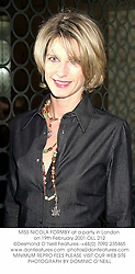 MISS NICOLA FORMBY at a party in London on 19th February 2001.	OLL 212