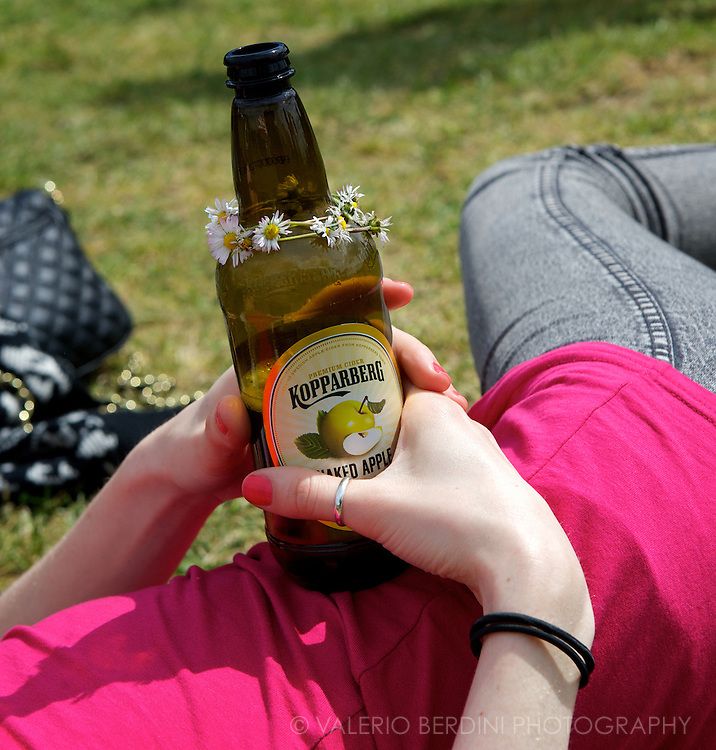 A girl enjoys her decorated cider at Field Day in London in Victoria Park 25 may 2013